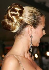 Heidi Klum adds elegance to the braided bun by polishing the front.