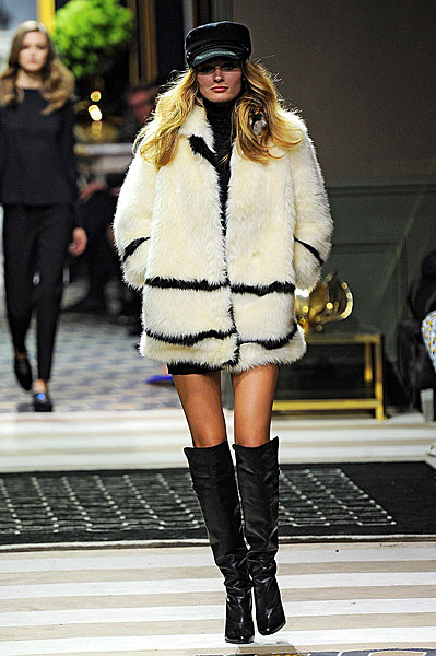 This heavy  faux fur ivory coat with black trim is on my Christmas list already!