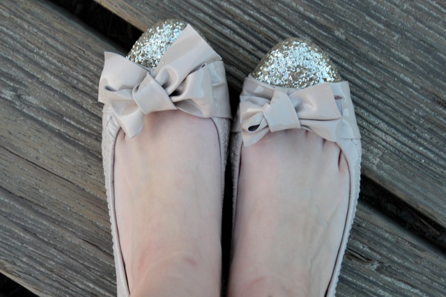 Ballet flats are ok for an impromptu trip to the beach as long as you stay off the sand.