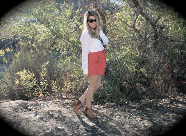 Top: Equipment Skirt: Helmut Lang Boots: Joie Sunglasses: Linda Farrow for the Row