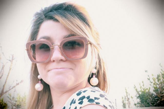 Sunglasses: Miu Miu Earrings: Tarina Tarantino