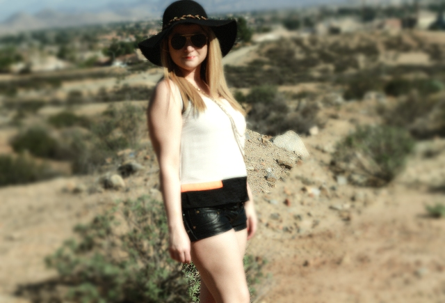 Top: Helmut Lang Shorts: Planet Funk Hat: Saks